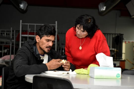 Dora Carillo speaks with her son David during dinner at the new SPIRIT of Santa Paula shelter. The family has been homeless for years.