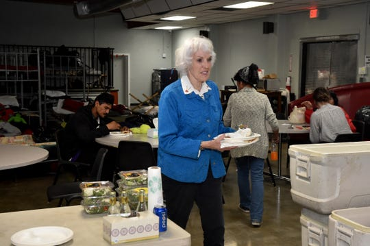 Kay Wilson-Bolton, director of SPIRIT of Santa Paula, helps with cleanup during the dinner hour at the organization's new homeless shelter.