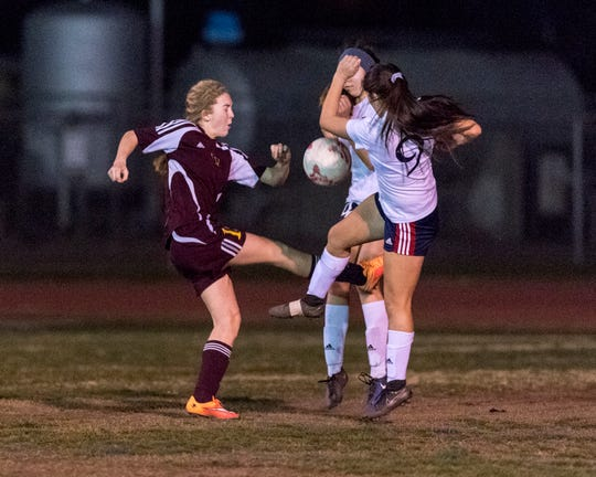 Tulare Union's Jaci Maze, left, in an East Yosemite League high school girls soccer game against Tulare Western on Wednesday, February 7, 2018.