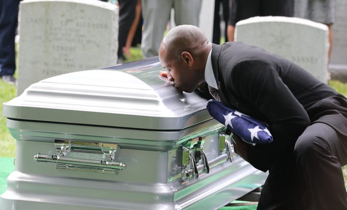 Christopher C. Morgan kisses the casket of his son, West Point Cadet Christopher J. Morgan, during the interment ceremony at West Point, June 15, 2019. Over 1500 family, friends and military personnel attended, as well as former President Bill Clinton who delivered remarks at the memorial service.
