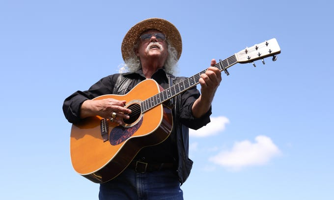 legendary folk singer Arlo Guthrie sings Bob Dylan's 'The Times Are a Changin' on festival field during Woodstock 50th anniversary celebration at Bethel Woods Center for the Arts in Bethel on Thursday, August 15, 2019.
