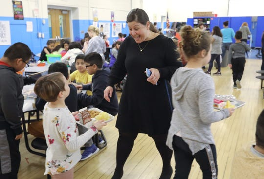 Principal Kelly Benadi visits the cafeteria during a lunch period at R.P. Connor Elementary School in Suffern Dec. 9, 2019.