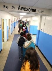 Students walk to the cafeteria for lunch at R.P. Connor Elementary School in Suffern Dec. 9, 2019.
