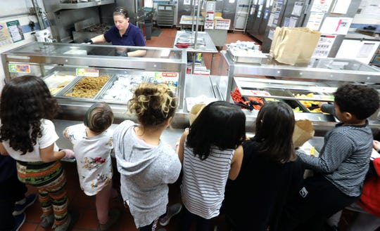 Students in Suffern, New York work their way down the lunch counter on Dec. 9, 2019.
