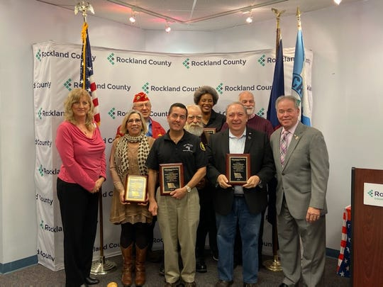 Seven Rocklanders were honored on Tuesday, Dec. 10, 2019, for their support of the veterans community. At left is Rockland Veterans Service Agency Director Susan Branam; at right in Rockland Executive Ed Day.