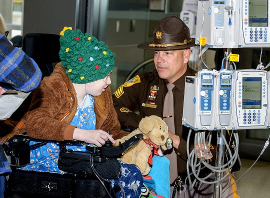A New Castle County Police Officer speaks with Kaden Morrison at Nemours/Alfred I. duPont Hospital for Children on Friday, Dec. 6, 2019.