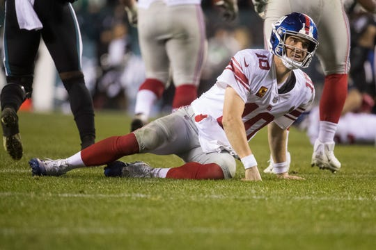 Giants' Eli Manning (10) looks at the ref after taking a hard hit Monday night against the Eagles. The Eagles defeated the Giants in overtime 23-17.