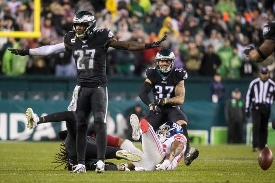 Eagles' Malcolm Jenkins celebrates a third down stop Monday night against the Giants. The Eagles defeated the Giants in overtime 23-17.