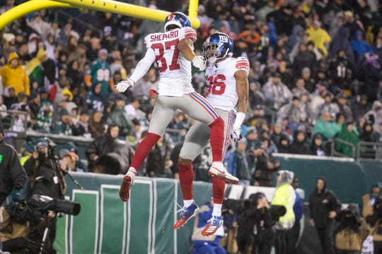 New York's Sterling Shepard (87) and Darius Slayton (86) celebrate a touchdown Monday night against the Eagles.