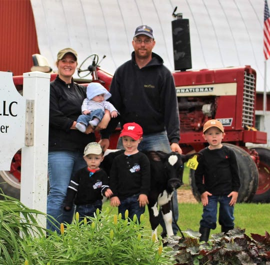 Travis and Krista Klinkner of Genoa, Wis., are joined by their four children, from left, Alice, 1, Hank, 2, Brad, 3, and  Liam, 4.