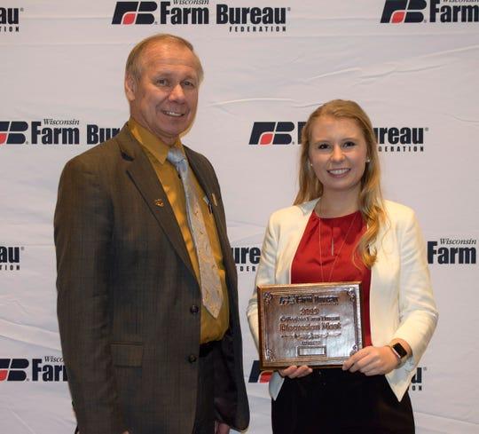WFBF President Jim Holte joins Meikah Dado, winner of the Wisconsin Farm Bureau's Collegiate Discussion Meet.