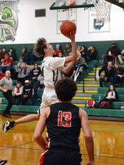 Alex Bronden, of Fisher Catholic, goes up for a shot during a 61-53 win against visiting Crooksville on Monday in Lancaster.