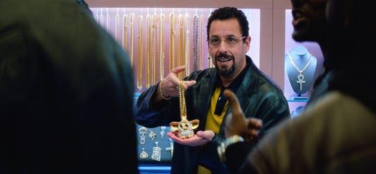 "Adam Sandler transforms into jeweler Howard Ratner in ""Uncut Gems."""