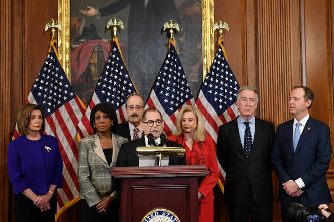 From left, House Speaker Nancy Pelosi, Chairwoman of the House Financial Services Committee Maxine Waters, D-Calif., Chairman of the House Foreign Affairs Committee Eliot Engel, D-N.Y., House Judiciary Committee Chairman Jerrold Nadler, D-N.Y., Chairwoman of the House Committee on Oversight and Reform Carolyn Maloney, D-N.Y., House Ways and Means Chairman Richard Neal and Chairman of the House Permanent Select Committee on Intelligence Adam Schiff, D-Calif., unveil articles of impeachment against President Donald Trump, during a news conference on Capitol Hill in Washington, Dec. 10, 2019.