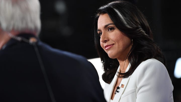 Democratic presidential hopeful Representative for Hawaii Tulsi Gabbard speaks to the press in the Spin Room following the fifth Democratic primary debate of the 2020 presidential campaign season co-hosted by MSNBC and The Washington Post at Tyler Perry Studios in Atlanta, Georgia on November 20, 2019. (Photo by Nicholas Kamm / AFP) (Photo by NICHOLAS KAMM/AFP via Getty Images) ORG XMIT: Fifth Dem ORIG FILE ID: AFP_1MG0GN