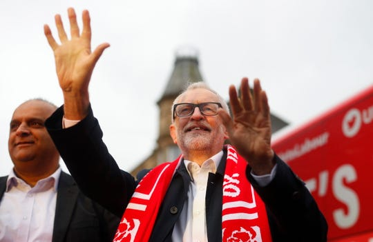 Britain's Labour Party leader Jeremy Corbyn greets supporters during a campaign rally.