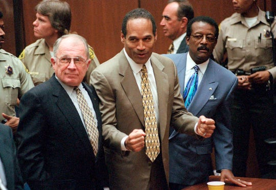 """""""O.J.: Made in America"""" (ESPN), a documentary about the murder trial of O.J. Simpson (with lawyers F. Lee Bailey, left, and Johnnie Cochran) in the 1990s."""