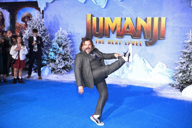 Jack Black poses on the red carpet prior to the premiere of the movie 'Jumanji: The Next Level' at the TCL Chinese Theater in Los Angeles on December 9, 2019.