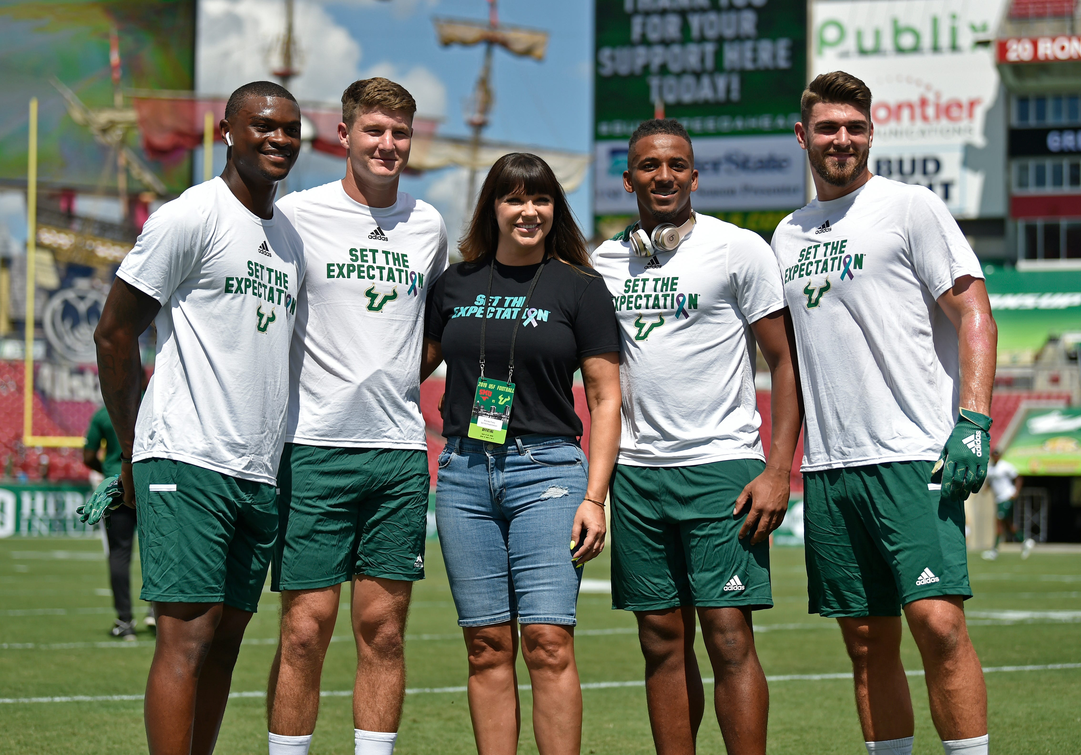 Rape survivor Brenda Tracy and University of South Florida football players show support for her nonprofit, Set The Expectation, dedicated to preventing sexual assault. Photographed Sept. 28, 2019, in Tampa Florida.
