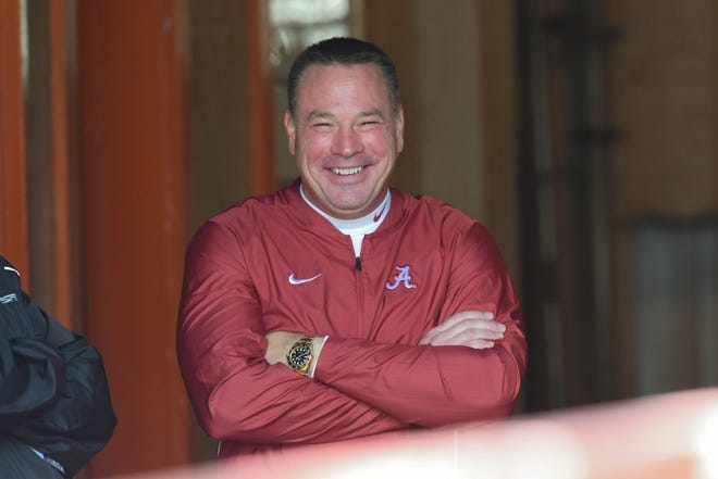 Crimson Tide analyst Butch Jones relaxes before the game against the Volunteers at Neyland Stadium.