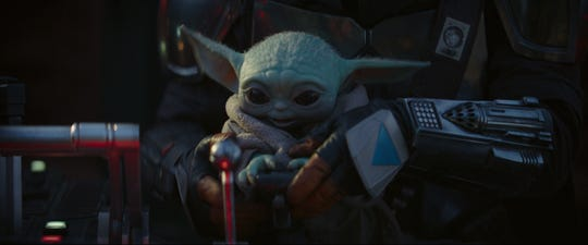 """Baby Yoda is the adorable little guy who flies through space with his armored guardian, the title character of """"The Mandalorian."""""""