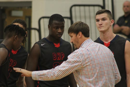 BHP coach Russ Tysl giving his players instruction during a timeout.