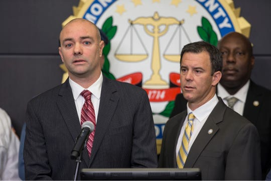Jef Henninger, left, attorney representing the Terrulli family, speaks to the media after Monmouth County Prosecutor Christopher Gramiccioni announced an Ocean Township man has been charged with the murder of Jacqueline Terrulli in her Ocean Township home.   Freehold, NJ Wednesday, December 11, 2019