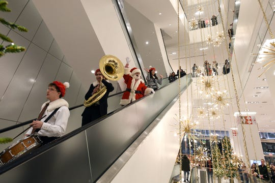 Santa Claus comes to town in a daily parade through Nordstrom's Manhattan flagship store during the holiday season.