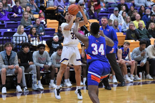 Wylie's Payton Brooks (32) takes a 3-pointer against San Angelo Central at Bulldog Gym on Tuesday. Brooks scored a game-high 20 points as Bulldogs won 67-38 for their third-straight win.