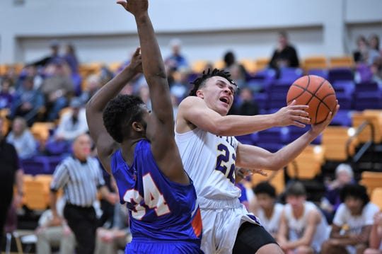 Wylie's Shayden Payne (22) get fouled as he goes up for a layup against San Angelo Central at Bulldog Gym on Tuesday. Payne was one of 12 Bulldogs to score and one of seven to score at least four points in the 67-38 win.