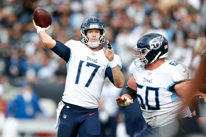 Tennessee Titans quarterback Ryan Tannehill (17) passes against the Oakland Raiders during the first half in Oakland, Calif., Sunday, Dec. 8, 2019.