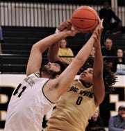Abilene High's Devyan Wilkins, left, battles Big Spring's Abel Clark for a rebound in the first half. The Eagles beat Big Spring 93-30 in the nondistrict game Tuesday, Dec. 10, 2019, at Eagle Gym.