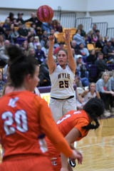 Wylie's Makinlee Bacon (25) takes a 3-pointer against San Angelo Central at Bulldog Gym on Tuesday. Bacon hit an early 3 and then knocked down a pair of fourth-quarter free throws as the Lady Bulldogs held on for the 28-22 win.