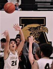 Abilene High's Jackson Stevens (21) shoots a 3-point goal in the first half against Big Spring. The Eagles beat the Steers 93-30 in the nondistrict game Tuesday, Dec. 10, 2019, at Eagle Gym.