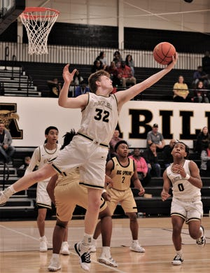 Abilene High's Nathan Watts (32) pulls down a rebound as teammate Pooh Johnson (0) and Big Spring's Zephaniah Nelson (2) look on. AHS beat the Steers 93-30 in the nondistrict game Tuesday, Dec. 10, 2019, at Eagle Gym.