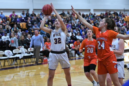 Wylie's Kenyah Maroney (32) takes a shot against San Angelo Central at Bulldog Gym on Tuesday. Maroney scored a game-high eight points in the Lady Bulldogs 28-22 win on Coaches vs. Cancer night.