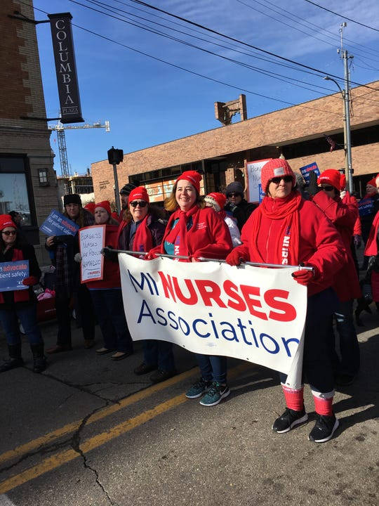 Jamie Brown, RN at Borgess Hospital in Kalamazoo, marching with other Borgess nurses in the Kalamazoo holiday parade.