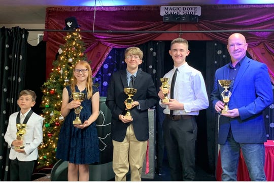 Magic Dove Magician of the Year winners include, from left, Carter Concannon, Megan Waryk, Justin Cowgill, Conner Harrell and Todd Brogue.