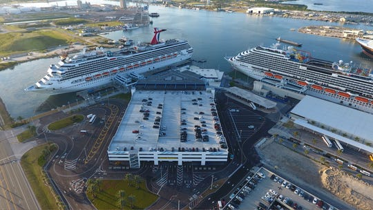 The Carnival Valor, left, is docked at Port Canaveral's Cruise Terminal 5 and the Carnival Magic is docked at Cruise Terminal 6. CANAVERAL PORT AUTHORITY PHOTO