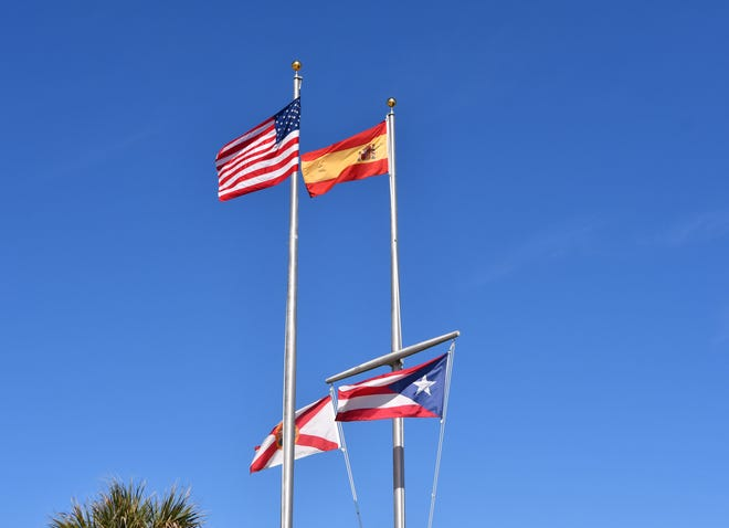 The flag of Spain, top right, and Puerto Rico, bottom right, will remain on display at Juan Ponce de Leon Landing south of Melbourne Beach, after a 3-2 vote by the Brevard County Commission. The display also includes the U.S. and Florida flags.