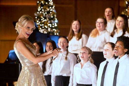 "Kristin Chenoweth stars as a youth choir director in ""A Christmas Love Story"" on the Hallmark Channel."