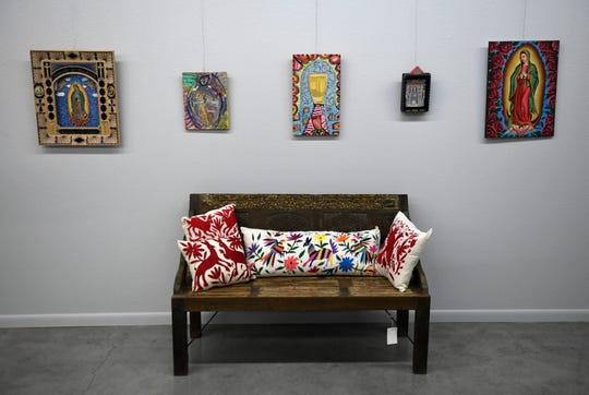 Mi Vida Loca Gallery features Mexican-style art and imports, as seen photographed on Wednesday, Dec. 11, 2019. Co-owners Mark Clark and Tinker Trombley showcase their Virgin de Guadelupe exhibit.