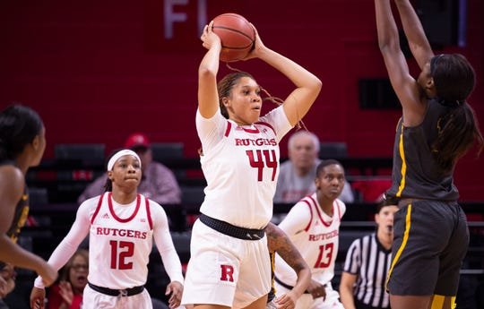 Rutgers University player Jordan Wallace (center) looks to pass the ball against Coppin State at the RAC in Piscataway on November 9, 2019. Wallace is having a solid senior season for Rutgers.