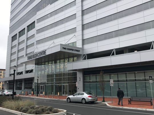 The Teamsters Union wants to block the transfer of a liquor license to a Cooper Street office building on Camden's Waterfront.