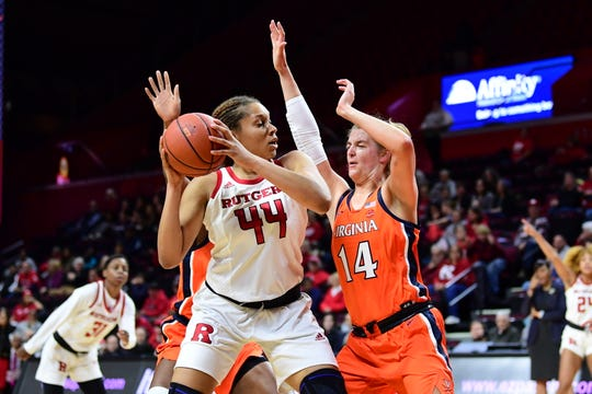 Rutgers University senior center Jordan Wallace looks for options in a game against the University of Virginia. Wallace, a former Sterling High School standout, is playing well in her final collegiate season.