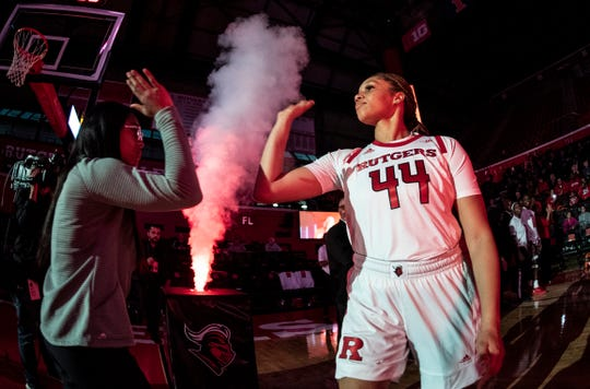 Jordan Wallace, a former Sterling High standout, slaps hands during introductions as the Rutgers Scarlet Knights women's basketball team takes on Coppin State at the RAC in Piscataway on Saturday, November 9.