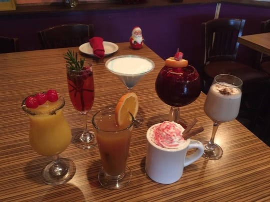 A variety of holiday cocktails at Tortilla Press Cantina includes (clockwise from left): Very Gritty X-Mas, Pomegranate Rose Fizz Champagne Cocktail, Frostbite Martini, Perfect Winter Cheer Sangria, Coquito, Mexican hot chocolate and hot spiced cider.