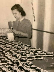A vintage photo shows Bunny Oakford making chocolate Easter eggs at Aunt Charlotte's Candies in Merchantville.