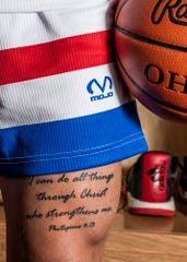 """Colby Swain has Philippians 4:13 - """"I can do all things through Christ who strengthens me"""" - tattooed on his leg as a reminder that no matter what happens he can do whatever he sets his mind to."""