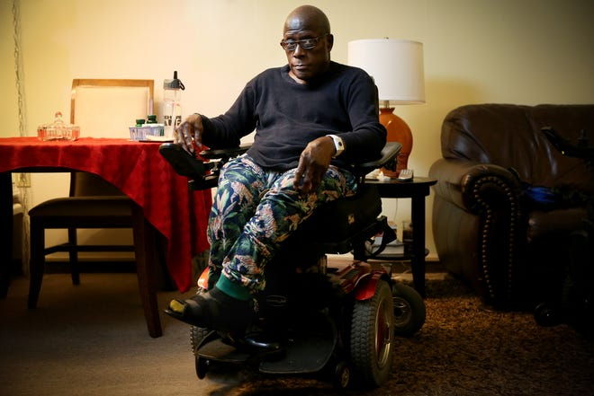 Freddie Brewton poses for a portrait, Wednesday, Dec. 4, 2019, in Cincinnati's Oakley neighborhood. He has mobility problems as a result of suffering rickets as a child and is asking for a new wheelchair and special utensils to help him eat by himself.